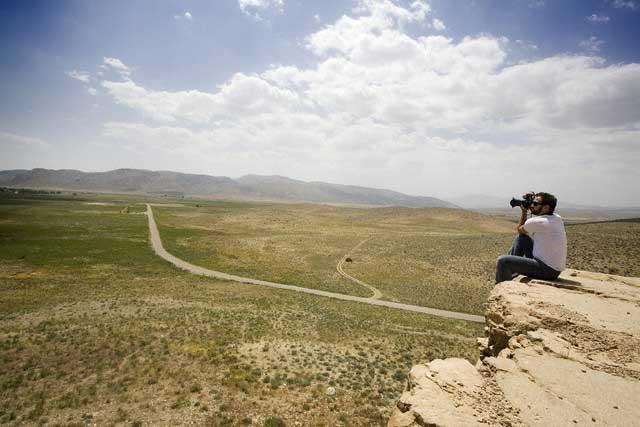 Man Photographing Desert Landscape