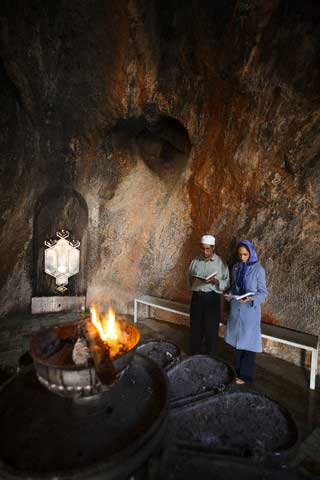 Couple Praying at Zoroastrian Temple