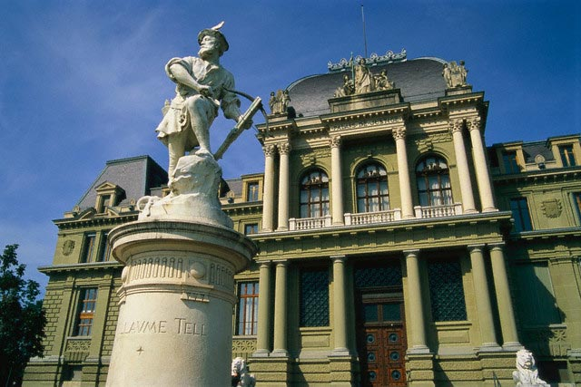 Palais de Justice and William Tell Statue in