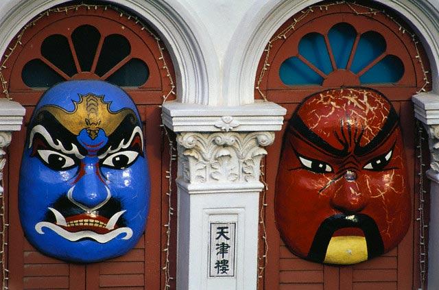 Chinese Masks Hanging on Doors