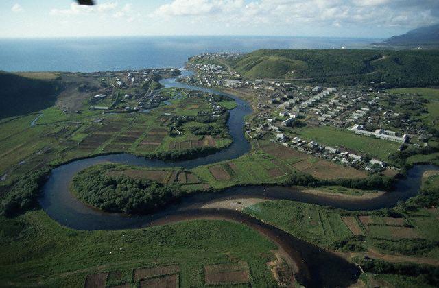 Oxbow River Flowing Through Farmland